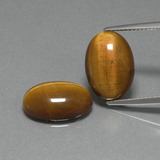 thumb image of 8.9ct Oval Cabochon Gold Brown Tiger's Eye (ID: 396674)