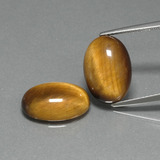 thumb image of 9.2ct Oval Cabochon Gold Brown Tiger's Eye (ID: 396675)
