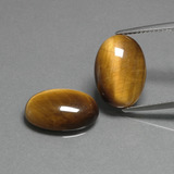 thumb image of 8.8ct Oval Cabochon Gold Brown Tiger's Eye (ID: 396764)
