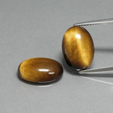 thumb image of 9.1ct Oval Cabochon Gold Brown Tiger's Eye (ID: 396881)