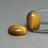 thumb image of 8.8ct Oval Cabochon Gold Brown Tiger's Eye (ID: 396892)