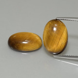 thumb image of 9.1ct Oval Cabochon Gold Brown Tiger's Eye (ID: 396986)