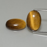 thumb image of 8.9ct Oval Cabochon Gold Brown Tiger's Eye (ID: 396987)