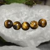 thumb image of 19.1ct Drilled Sphere Gold Brown Tiger's Eye (ID: 469124)