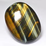 thumb image of 68.1ct Oval Cabochon Multicolor Tiger's Eye (ID: 518949)